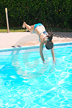 Woman Jumping To Swimming Pool Royalty Free Stock Photo - Image: 20106545