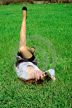 Happy Lady On Grass Stretching Leg (2) Royalty Free Stock Images - Image: 20116269