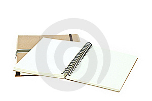 Open Note Book On Brown Book Royalty Free Stock Photo - Image: 20134465