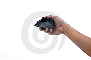 Male Hand Holding A Little Lump Of Coal Stock Image - Image: 20142981