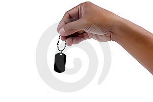 Male Hand Holding A Black Metal Blank Tag Royalty Free Stock Photography - Image: 20143137