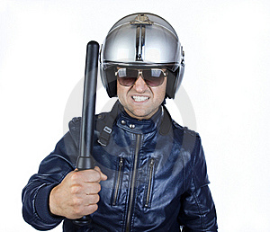 Policeman Is Holding A Stick Royalty Free Stock Photo - Image: 20150645