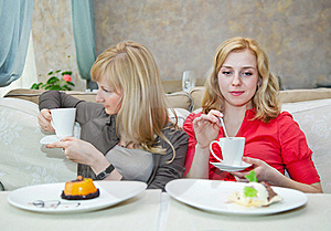 Two Young Women In Cafe Royalty Free Stock Image - Image: 20155556