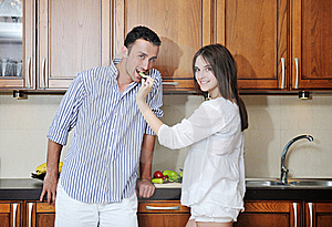 Happy Young Couple Have Fun In Modern Kitchen Royalty Free Stock Photo - Image: 20161175