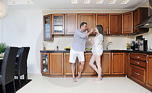 Happy Young Couple Have Fun In Modern Kitchen Stock Photo - Image: 20161210