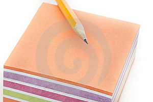 A Colorful Note Pad With A Pencil Stock Photo - Image: 20185180
