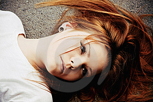 Portrait Of Beautiful Young Girl Lying On Asphalt Royalty Free Stock Photography - Image: 20186037