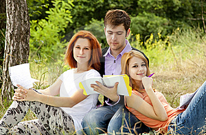 Students At Outdoor Doing Homework. Stock Images - Image: 20196144