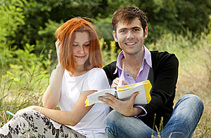 Students At Outdoor Doing Homework. Royalty Free Stock Photos - Image: 20196228