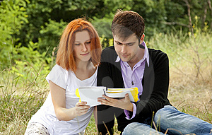 Students At Outdoor Doing Homework. Royalty Free Stock Images - Image: 20196229