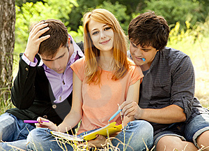 Students At Outdoor Doing Homework. Royalty Free Stock Photos - Image: 20196398