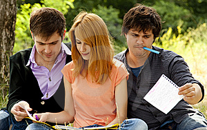 Students At Outdoor Doing Homework. Stock Image - Image: 20196451