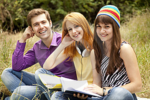 Students At Outdoor Doing Homework. Royalty Free Stock Image - Image: 20196756