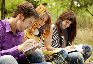 Students At Outdoor Doing Homework. Royalty Free Stock Photo - Image: 20196765