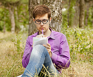 Funny Men With Glasses Doing Homework At The Park Royalty Free Stock Photos - Image: 20196958