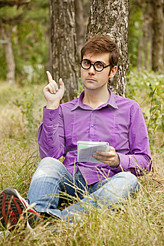 Funny Men With Glasses Doing Homework At The Park Royalty Free Stock Photos - Image: 20197008