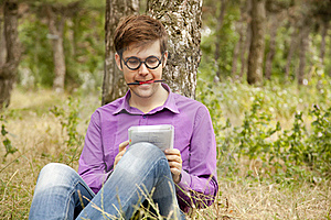 Funny Men With Glasses Doing Homework At The Park Stock Images - Image: 20197014