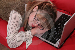 Sleeping  business woman and laptop Royalty Free Stock Photography
