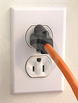 Wall Outlet - orange Plug Royalty Free Stock Images
