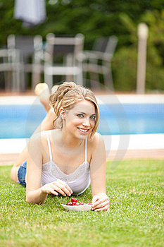 Young Woman Eating A Cherries On The Grass Stock Photo - Image: 20207210