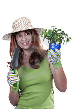 Redhead Woman Working In The Garden Royalty Free Stock Image - Image: 20226886