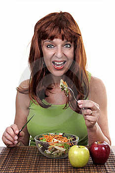 Redhead Woman Eating Royalty Free Stock Photography - Image: 20226947