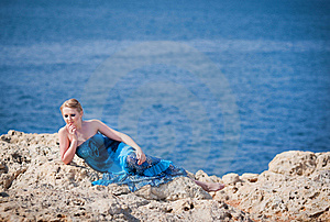 Pretty Woman On The Rocky Mountain Near The Sea Royalty Free Stock Image - Image: 20231516