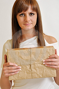 Girl With A Package Stock Image - Image: 20244701