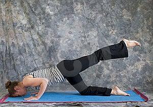 Woman Doing Yoga Posture Sunbird Pose Left Royalty Free Stock Photo - Image: 20249355
