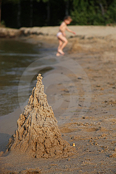 Sand Castle On Beach With Playing Child Royalty Free Stock Photo - Image: 20252265