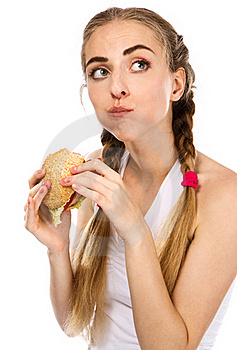 Young Woman Holding A Hamburger And An Apple Stock Photos - Image: 20253033