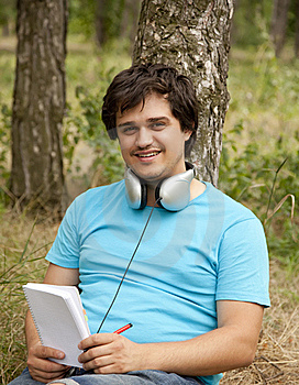Student With Notebook And Headphones. Stock Image - Image: 20276131