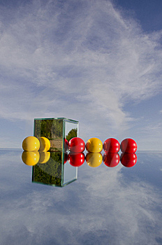 Red And Yellow Balls On Mirror And Sky Stock Photography - Image: 20277672