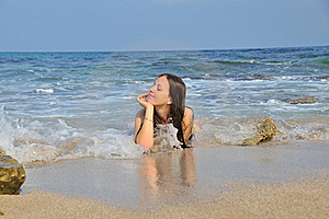 Girl Lying In The Sea Waves Stock Photo - Image: 20279010
