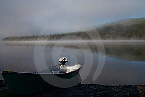 Boat On A Misty Lake Stock Image - Image: 20283241