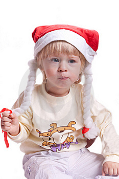 Little Girl In A Christmas Hat With Braids Royalty Free Stock Photo - Image: 20286295