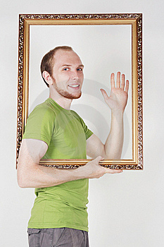 Man Holding Decorative Picture Frame Royalty Free Stock Photos - Image: 20291478