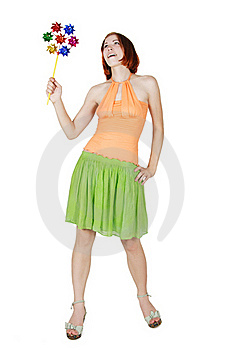Girl In Bright Clothes Holding Pinwheella Royalty Free Stock Image - Image: 20291496