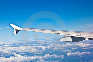 Wing Of The Plane With Blue Sky Royalty Free Stock Photo - Image: 20300125