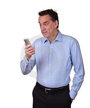 Attractive Man Looking Startled At Phone Stock Photography - Image: 20304302