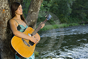 Young Woman Playing Guitar Royalty Free Stock Photography - Image: 20306947