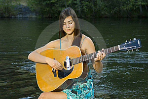 Young Woman Playing Guitar Royalty Free Stock Photography - Image: 20307037