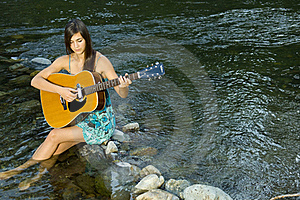 Young Woman Playing Guitar Stock Photos - Image: 20307063