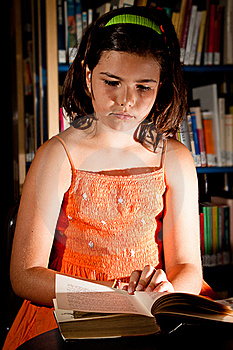 Young Girl Reading In Library Royalty Free Stock Photo - Image: 20308155