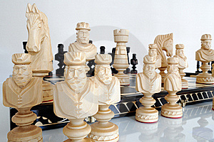 Chess Pieces On Wood Board Royalty Free Stock Photography - Image: 20308347