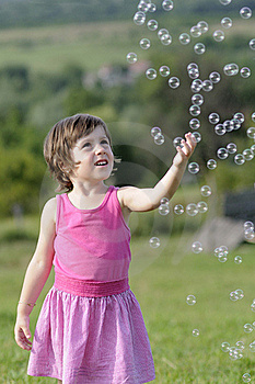 Pretty Child Catching Balloons Royalty Free Stock Image - Image: 20322866