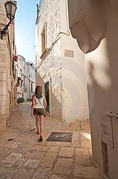 Girl In A Narrow Street Royalty Free Stock Photo - Image: 20350185