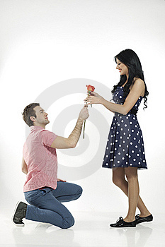 Romantic Boy Giving Rose To His Girlfriend Royalty Free Stock Image - Image: 20360176
