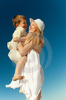 Boy Flying On His Mother's Hands Royalty Free Stock Images - Image: 20362989