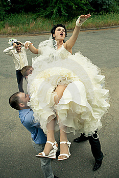 Bbride Tossed By A Group Of Groomsmen Stock Photography - Image: 20363002